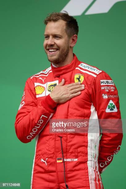 Race winner Sebastian Vettel of Germany and Ferrari celebrates on the podium during the Canadian Formula One Grand Prix at Circuit Gilles Villeneuve...
