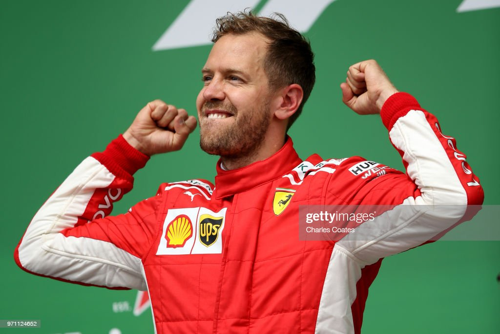 Race winner Sebastian Vettel of Germany and Ferrari celebrates on the podium during the Canadian Formula One Grand Prix at Circuit Gilles Villeneuve on June 10, 2018 in Montreal, Canada.