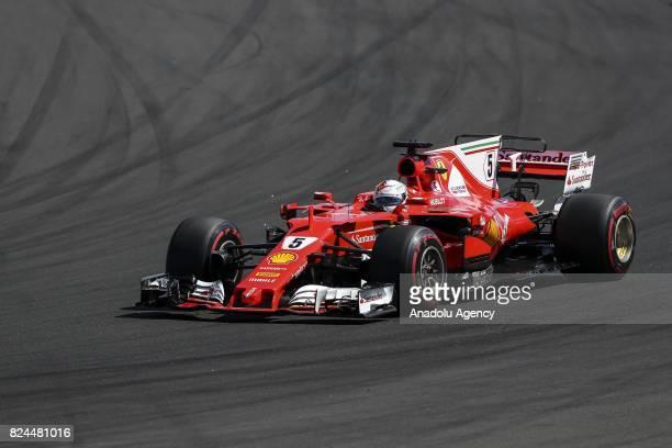 Race winner Sebastian Vettel of Germany and Ferrari drives his car during the Formula One Grand Prix of Hungary at Hungaroring on July 30 2017 in...