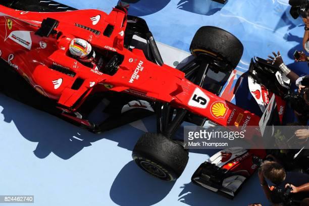 Race winner Sebastian Vettel of Germany and Ferrari pulls into parc ferme during the Formula One Grand Prix of Hungary at Hungaroring on July 30 2017...