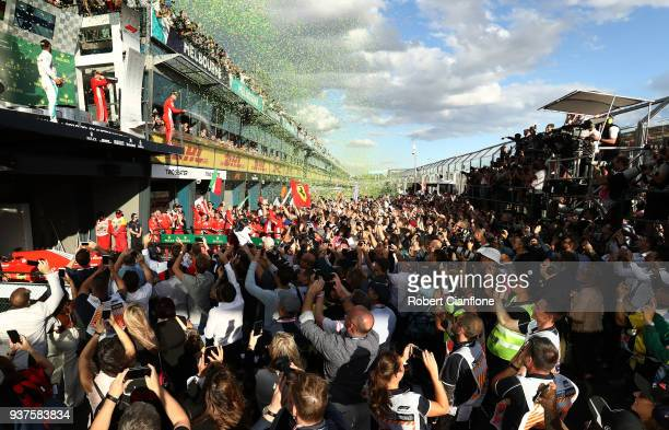 Race winner Sebastian Vettel of Germany and Ferrari, second place Lewis Hamilton of Great Britain and Mercedes GP and third placed Kimi Raikkonen of...