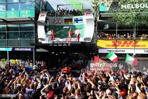 Race winner Sebastian Vettel of Germany and Ferrari second place Lewis Hamilton of Great Britain and Mercedes GP and third placed Kimi Raikkonen of...