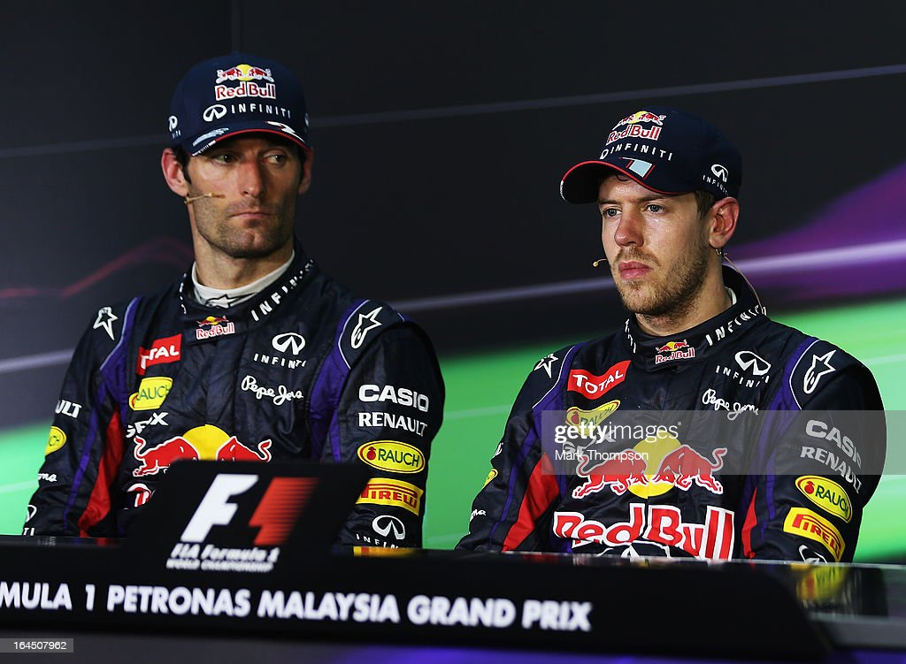 Race winner Sebastian Vettel (R) of Germany and Infiniti Red Bull Racing and second placed Mark Webber (L) of Australia and Infiniti Red Bull Racing react in the drivers press conference following the Malaysian Formula One Grand Prix at the Sepang Circuit on March 24, 2013 in Kuala Lumpur, Malaysia.