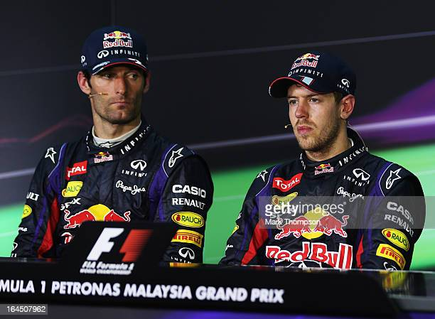 Race winner Sebastian Vettel of Germany and Infiniti Red Bull Racing and second placed Mark Webber of Australia and Infiniti Red Bull Racing react in...