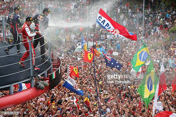 Race winner Sebastian Vettel of Germany and Infiniti Red Bull Racing second placed Fernando Alonso of Spain and Ferrari and third placed Mark Webber...