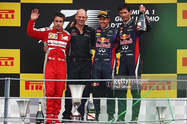Race winner Sebastian Vettel of Germany and Infiniti Red Bull Racing second placed Fernando Alonso of Spain and Ferrari third placed Mark Webber of...