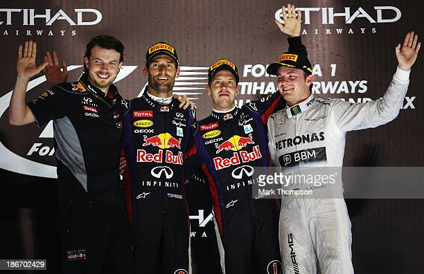 Race winner Sebastian Vettel of Germany and Infiniti Red Bull Racing celebrates on the podium with second placed Mark Webber of Australia and...