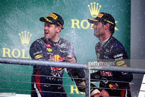 Race winner Sebastian Vettel of Germany and Infiniti Red Bull Racing celebrates on the podium with third placed Mark Webber of Australia and Infiniti...