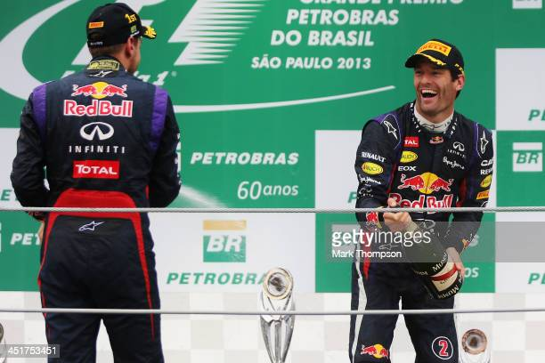 Race winner Sebastian Vettel of Germany and Infiniti Red Bull Racing celebrates on the podium with second placed team mate Mark Webber of Australia...