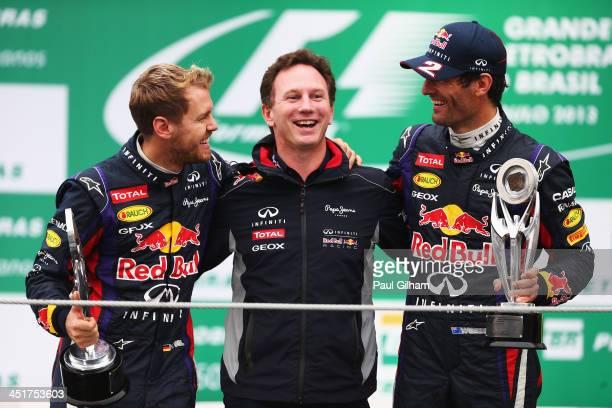 Race winner Sebastian Vettel of Germany and Infiniti Red Bull Racing, second placed team mate Mark Webber of Australia and Infiniti Red Bull Racing...