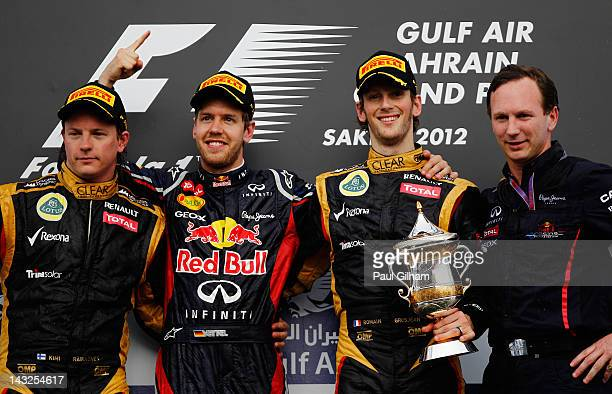 Race winner Sebastian Vettel of Germany and Red Bull Racing celebrates on the podium with second placed Kimi Raikkonen of Finland and Lotus third...