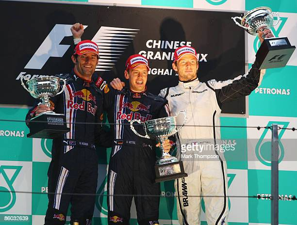 Race winner Sebastian Vettel of Germany and Red Bull Racing celebrates with second placed team mate Mark Webber of Australia and Red Bull Racing and...