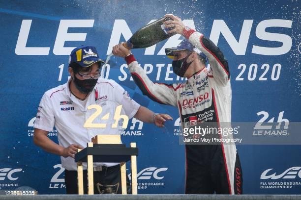 Race winner Sebastien Buemi of Switzerland and Toyota Gazoo Racing, celebrates on the podium at the Circuit de la Sarthe on September 20, 2020 in Le...