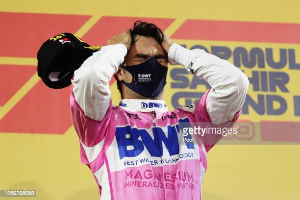 Race winner Sergio Perez of Mexico and Racing Point celebrates his maiden F1 victory on the podium during the F1 Grand Prix of Sakhir at Bahrain...