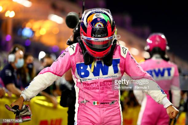 Race winner Sergio Perez of Mexico and Racing Point celebrates his maiden F1 victory in parc ferme during the F1 Grand Prix of Sakhir at Bahrain...
