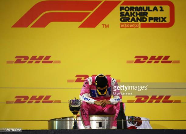 Race winner Sergio Perez of Mexico and Racing Point celebrates on the podium during the F1 Grand Prix of Sakhir at Bahrain International Circuit on...