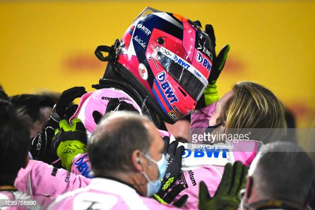 Race winner Sergio Perez of Mexico and Racing Point celebrates with team members in parc ferme during the F1 Grand Prix of Sakhir at Bahrain...