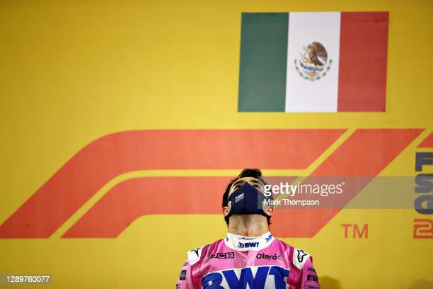 Race winner Sergio Perez of Mexico and Racing Point stands for the national anthem on the podium during the F1 Grand Prix of Sakhir at Bahrain...