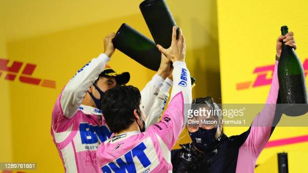 Race winner Sergio Perez of Mexico and Racing Point, third placed Lance Stroll of Canada and Racing Point and Andy Stevenson, Sporting Director of...