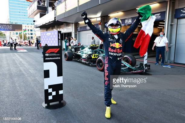 Race winner Sergio Perez of Mexico and Red Bull Racing celebrates in parc ferme during the F1 Grand Prix of Azerbaijan at Baku City Circuit on June...