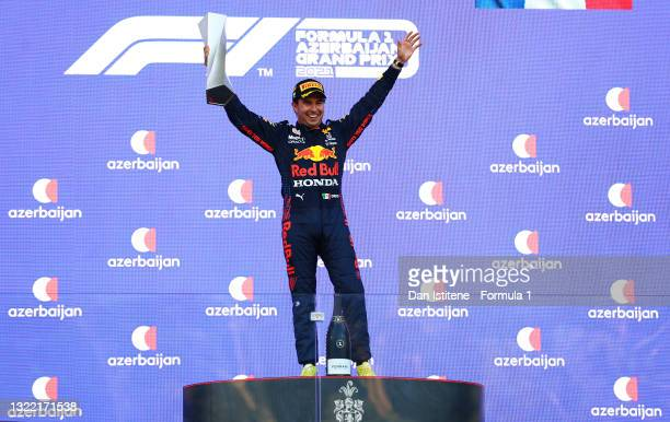 Race winner Sergio Perez of Mexico and Red Bull Racing celebrates on the podium during the F1 Grand Prix of Azerbaijan at Baku City Circuit on June...