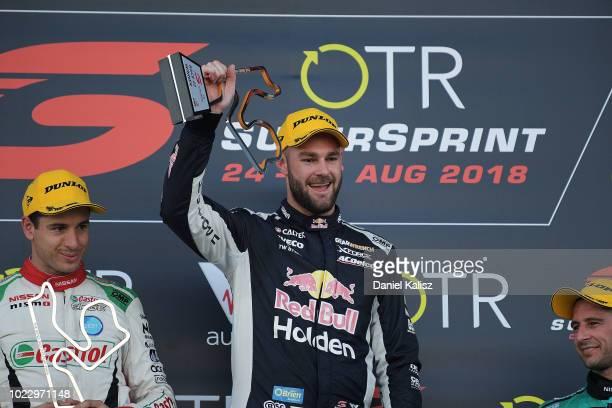 Race winner Shane Van Gisbergen driver of the Red Bull Holden Racing Team Holden Commodore ZB celebrates on the podium during race 22 for the...