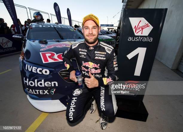 Race winner Shane Van Gisbergen driver of the Red Bull Holden Racing Team Holden Commodore ZB celebrates during race 22 for the Supercars SuperSprint...