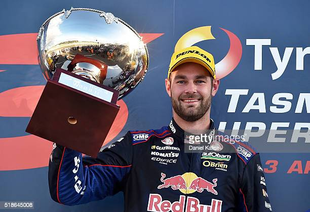 Race winner Shane Van Gisbergen driver of the Red Bull Racing Australia Holden Commodore VF reacts on the podium after Race 1 for the V8 Supercars...