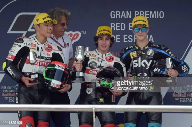 Race winner SIC58 Squadra Corse's Italian rider Niccolo Antonelli celebrates on the podium with second placed SIC58 Squadra Corse's Japanese rider...