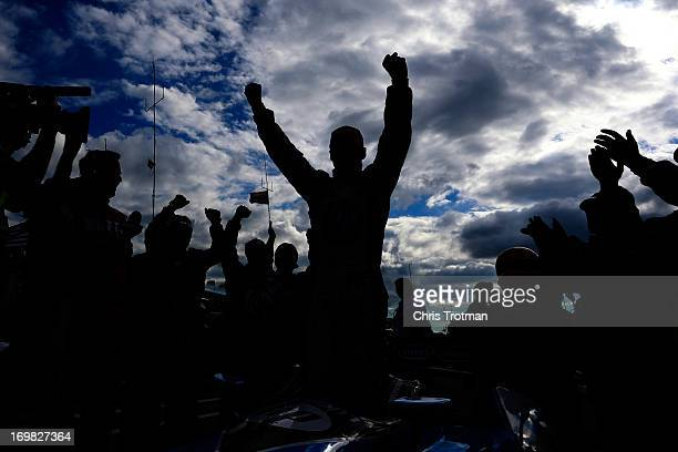 Race winner Simon Pagenaud of France driver of the Schmidt Hamilton HP Motorsports Honda celebrates in victory lane following his victory in the IZOD...