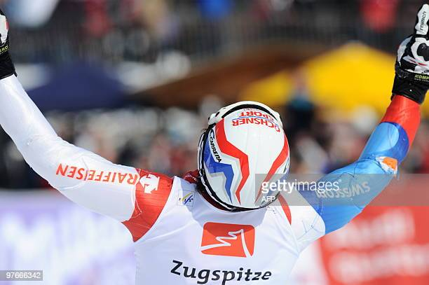 Race winner Switzerland's Carlo Janka celebrates in the finish area during the men's Alpine skiing World Giant Slalom finals in Garmisch...