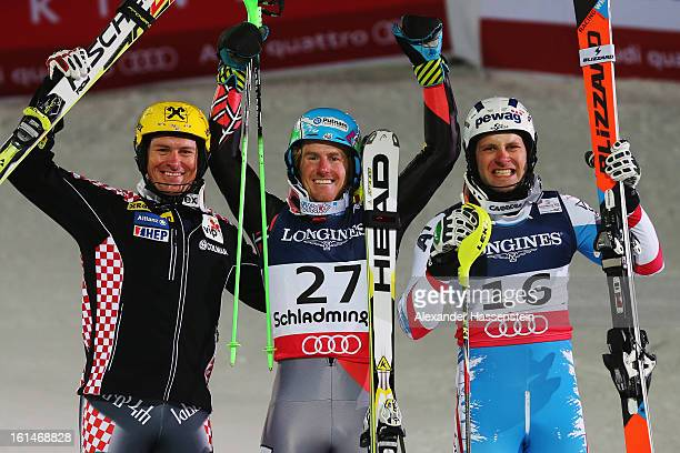 Race winner Ted Ligety of the United States of America celebrates with second placed Ivica Kostelic of Croatia and third placed Romed Baumann of...