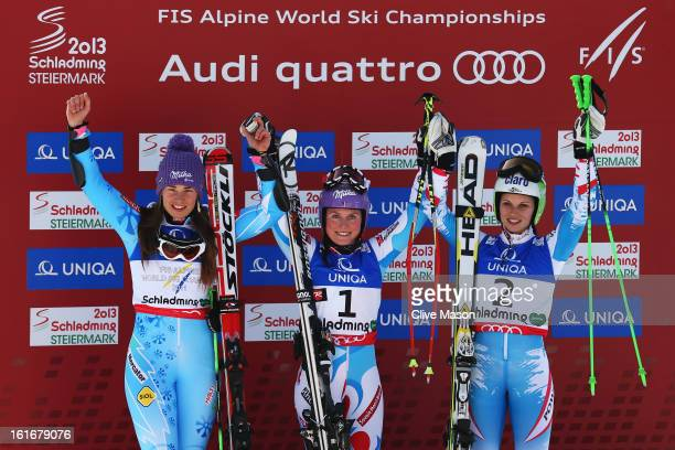 Race winner Tessa Worley of France celebrates at the flower ceremony with second placed Tina Maze of Slovenia and third placed Anna Fenninger of...