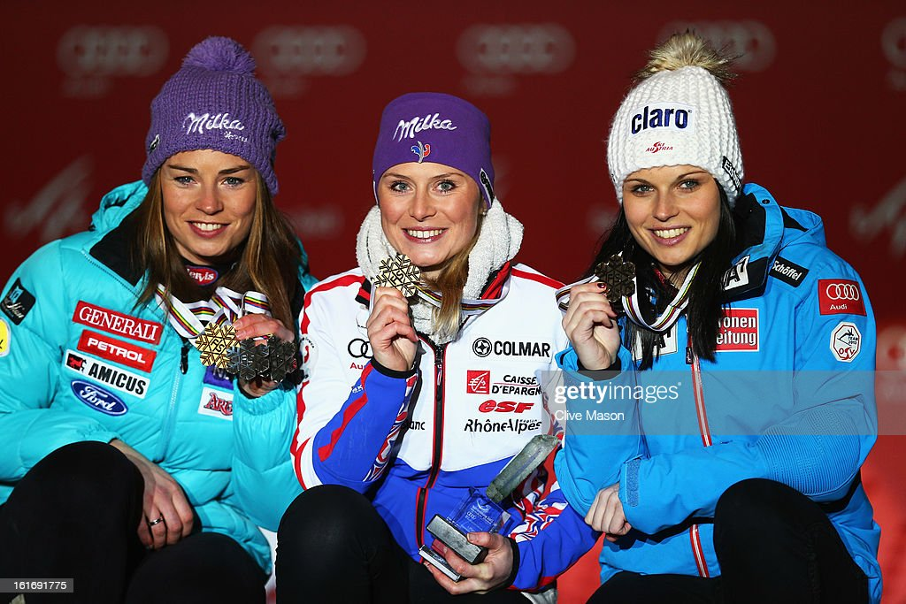 Race winner Tessa Worley (C) of France celebrates at the medal ceremony with second placed Tina Maze (L) of Slovenia and third placed Anna Fenninger (R) of Austria following the Women's Giant Slalom during the Alpine FIS Ski World Championships on February 14, 2013 in Schladming, Austria.