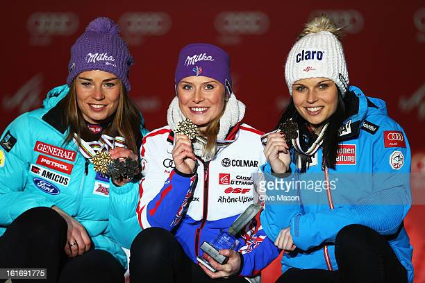 Race winner Tessa Worley of France celebrates at the medal ceremony with second placed Tina Maze of Slovenia and third placed Anna Fenninger of...