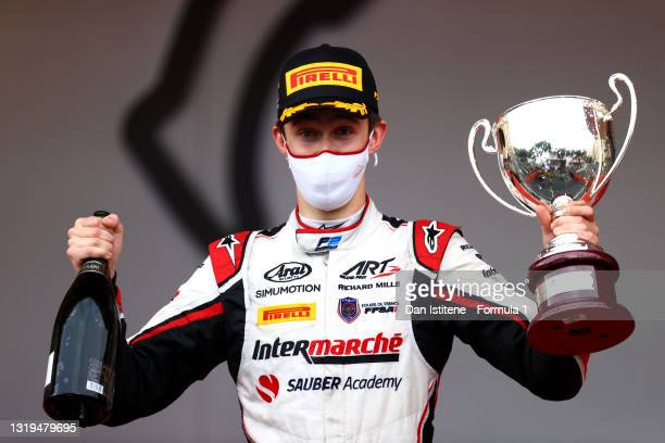 Race winner Theo Pourchaire of France and ART Grand Prix celebrates on the podium during the Feature Race of Round 2:Monte Carlo of the Formula 2...