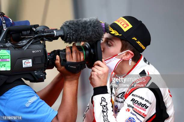 Race winner Theo Pourchaire of France and ART Grand Prix celebrates into a TV camera on the podium during the Feature Race of Round 2:Monte Carlo of...