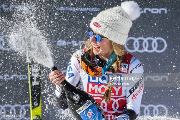Race winner USA's Mikaela Shiffrin sprays champagne during the podium ceremony after winning the Women's Super G event of the FIS Alpine skiing World...