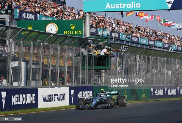 Race winner Valtteri Bottas driving the Mercedes AMG Petronas F1 Team Mercedes W10 takes the chequered flag during the F1 Grand Prix of Australia at...