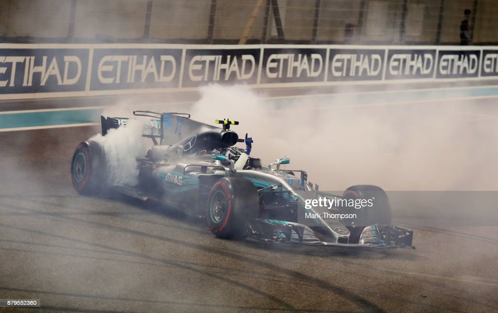 Race winner Valtteri Bottas driving the (77) Mercedes AMG Petronas F1 Team Mercedes F1 WO8 celebrates with donuts on track during the Abu Dhabi Formula One Grand Prix at Yas Marina Circuit on November 26, 2017 in Abu Dhabi, United Arab Emirates.