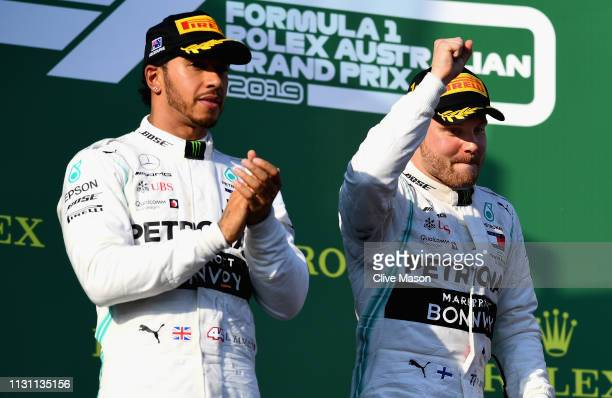 Race winner Valtteri Bottas of Finland and Mercedes GP and second placed Lewis Hamilton of Great Britain and Mercedes GP celebrate on the podium...
