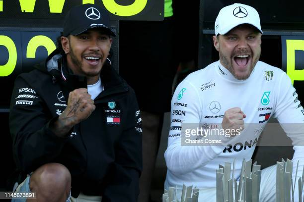 Race winner Valtteri Bottas of Finland and Mercedes GP and second placed Lewis Hamilton of Great Britain and Mercedes GP celebrate with their team...
