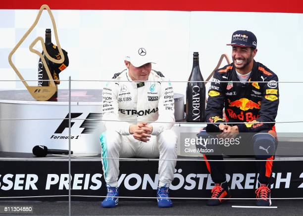 Race winner Valtteri Bottas of Finland and Mercedes GP and third place finisher Daniel Ricciardo of Australia and Red Bull Racing talk on the podium...