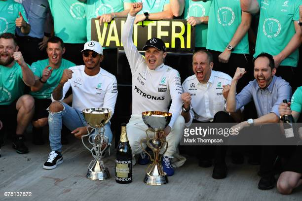 Race winner Valtteri Bottas of Finland and Mercedes GP celebrates his win with team mate Lewis Hamilton of Great Britain and Mercedes GP and the rest...