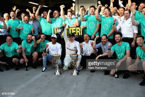Race winner Valtteri Bottas of Finland and Mercedes GP, celebrates his win with team mate Lewis Hamilton of Great Britain and Mercedes GP and the...
