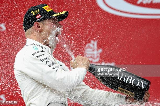 Race winner Valtteri Bottas of Finland and Mercedes GP celebrates his win on the podium during the Formula One Grand Prix of Austria at Red Bull Ring...