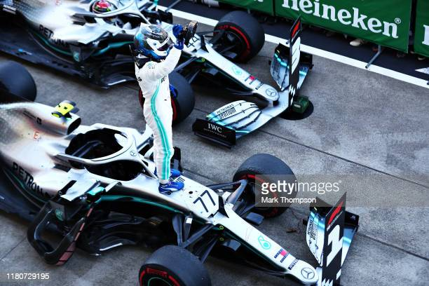 Race winner Valtteri Bottas of Finland and Mercedes GP celebrates in parc ferme during the F1 Grand Prix of Japan at Suzuka Circuit on October 13,...