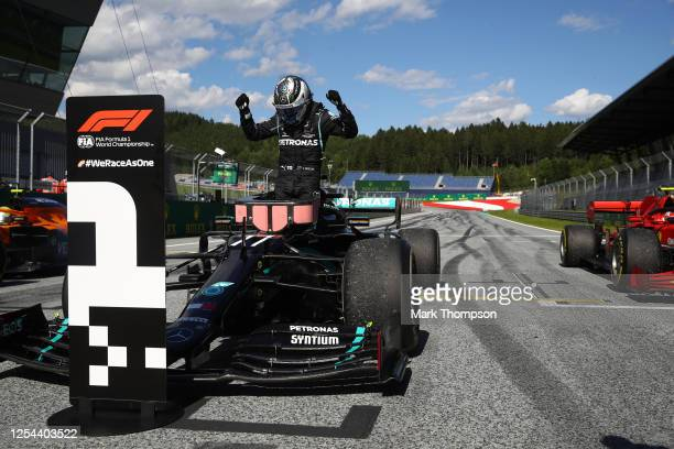 Race winner Valtteri Bottas of Finland and Mercedes GP celebrates in parc ferme during the Formula One Grand Prix of Austria at Red Bull Ring on July...