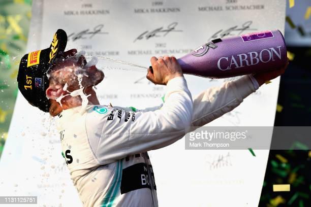Race winner Valtteri Bottas of Finland and Mercedes GP celebrates on the podium during the F1 Grand Prix of Australia at Melbourne Grand Prix Circuit...