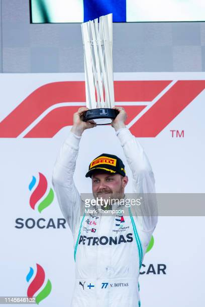 Race winner Valtteri Bottas of Finland and Mercedes GP celebrates on the podium during the F1 Grand Prix of Azerbaijan at Baku City Circuit on April...